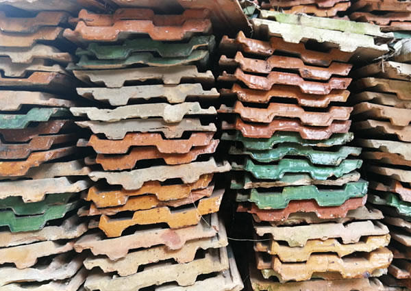 Stacks of terra cotta roof tiles—eco-friendly roofing
