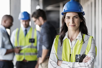 female professional with safety vest and hard hat